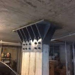 Reforço estrutural metálico no pilar
